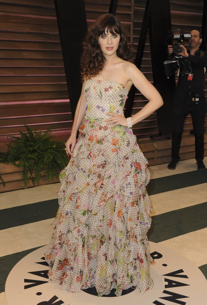 Zooey Deschanel sported a sexy, tousled look at the bash.