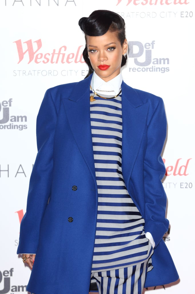 Rihanna kept her look sharp with a white collared Raf Simons top and sleek coif.