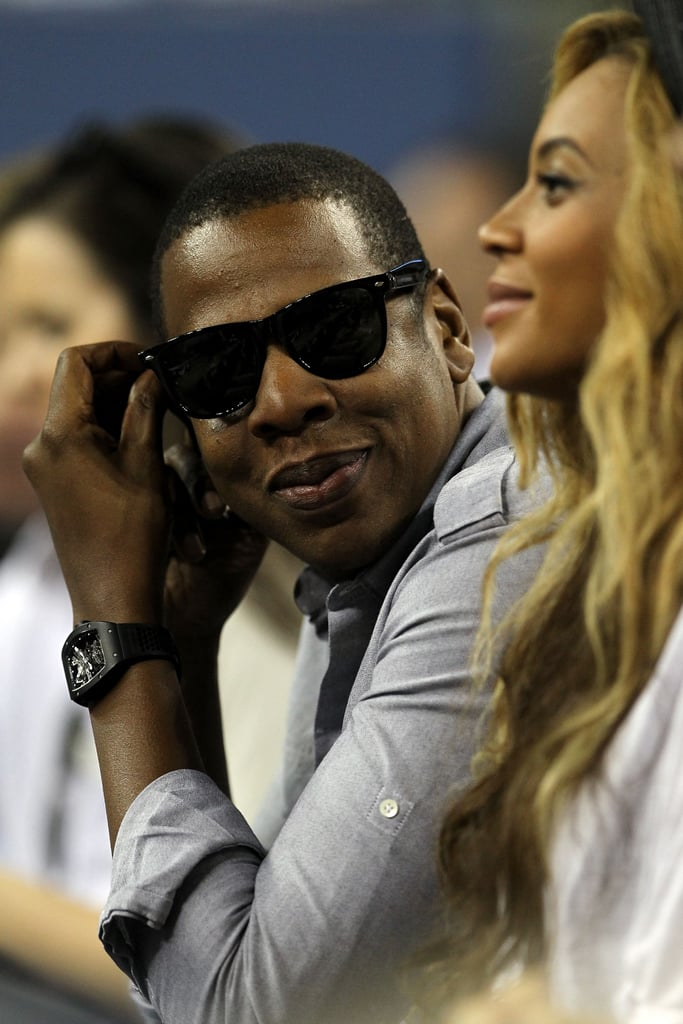 Jay-Z and Beyoncé Knowles hang out and watch tennis.