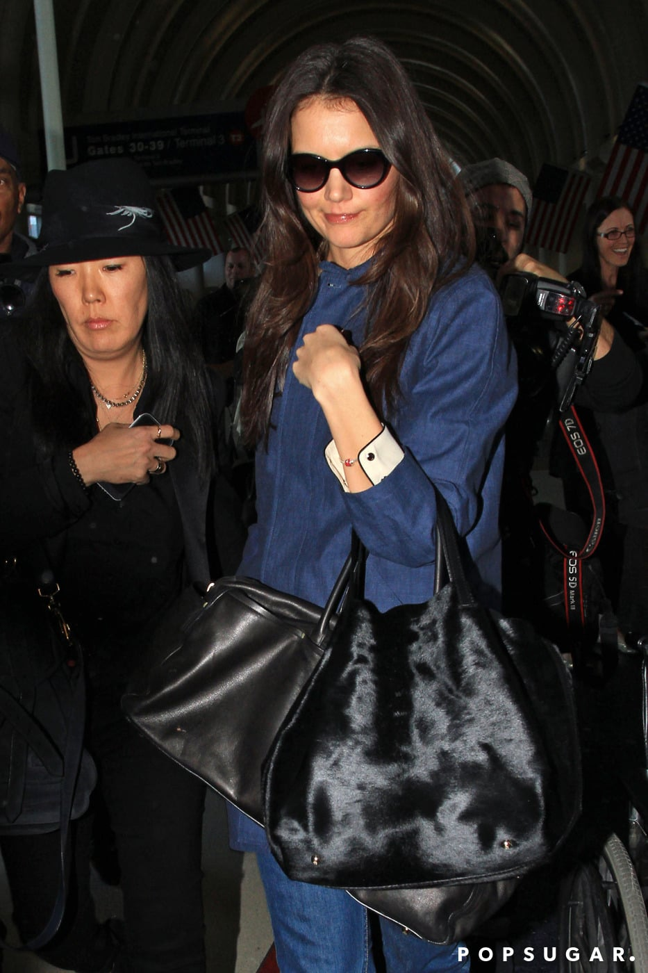 Katie Holmes was accompanied by her stylist and friend Jeanne Yang on Wednesday at LAX.