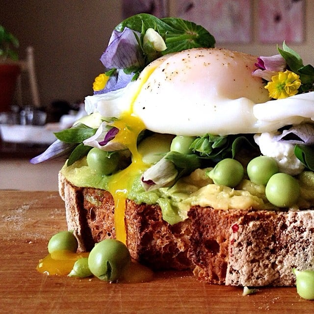 Two words: food porn. Between the edible flowers and fresh garden peas, this take on avocado toast needs to be duplicated ASAP. Source: Instagram user dennistheprescott