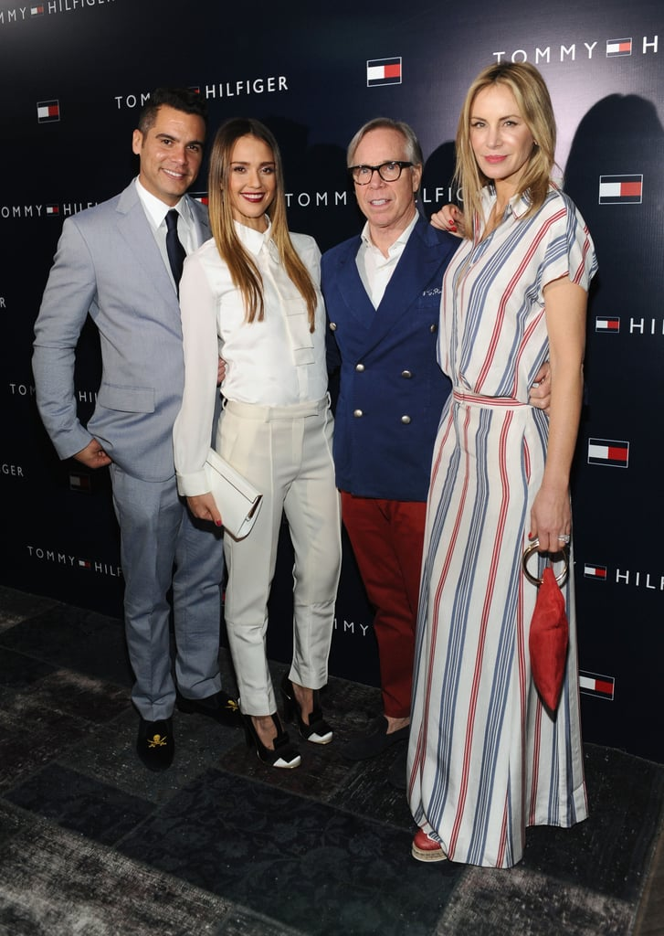 Jessica Alba and Cash Warren posed with Tommy Hilfiger and wife Dee.