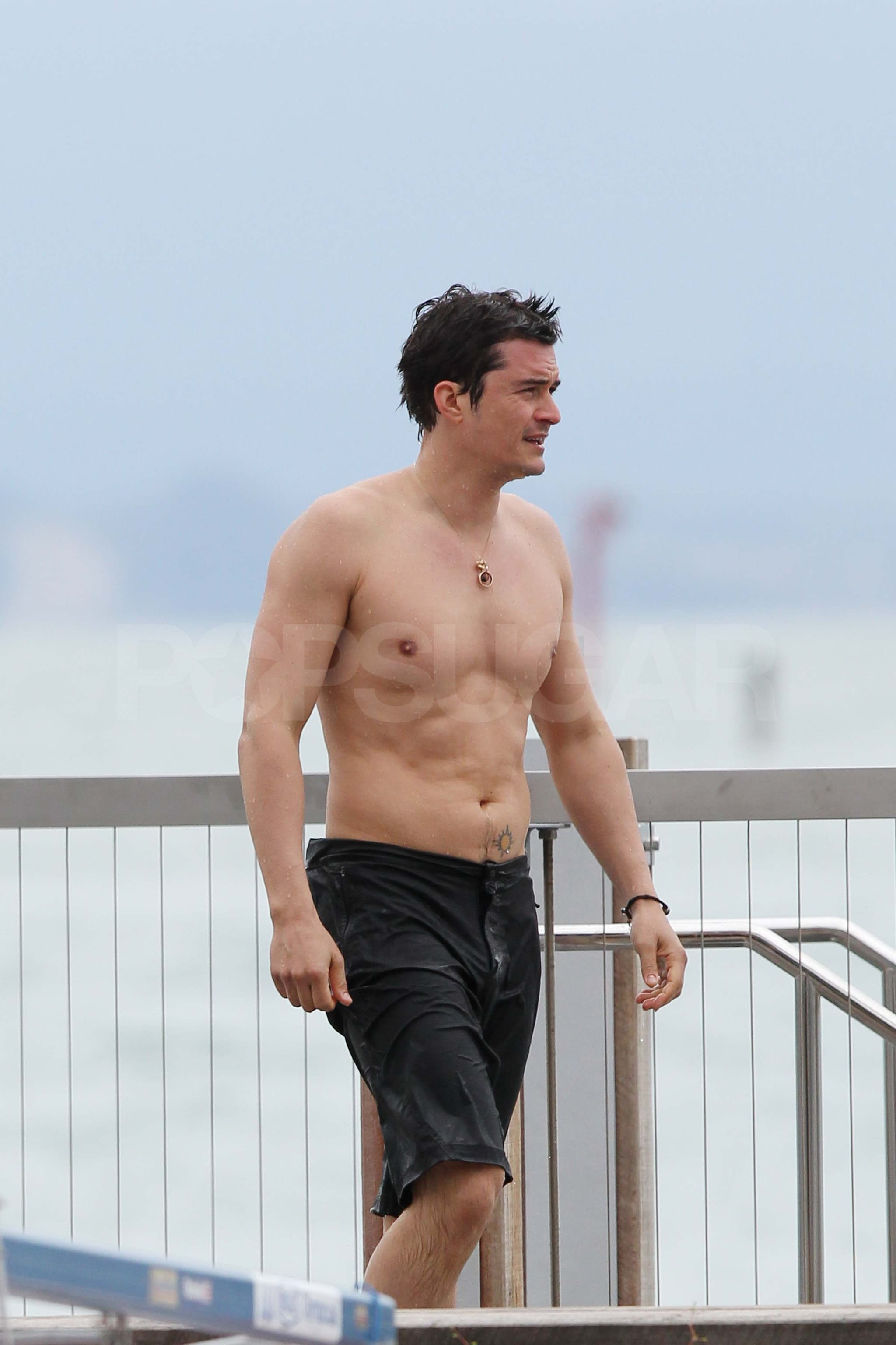 Shirtless Orlando Bloom swimming in New Zealand.