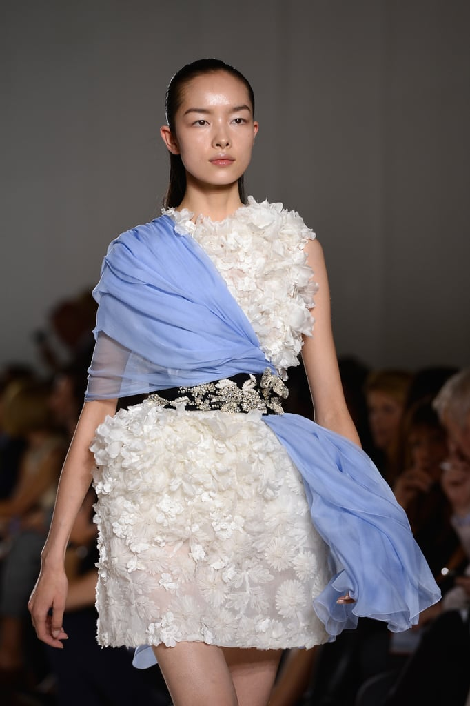 White blossoms contrasted with smooth periwinkle fabric charmed us at Giambattista Valli Haute Couture Fall 2013.