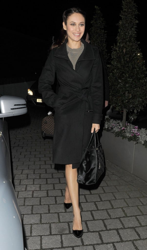 Olga Kurylenko carried a purse with her to the helicopter.