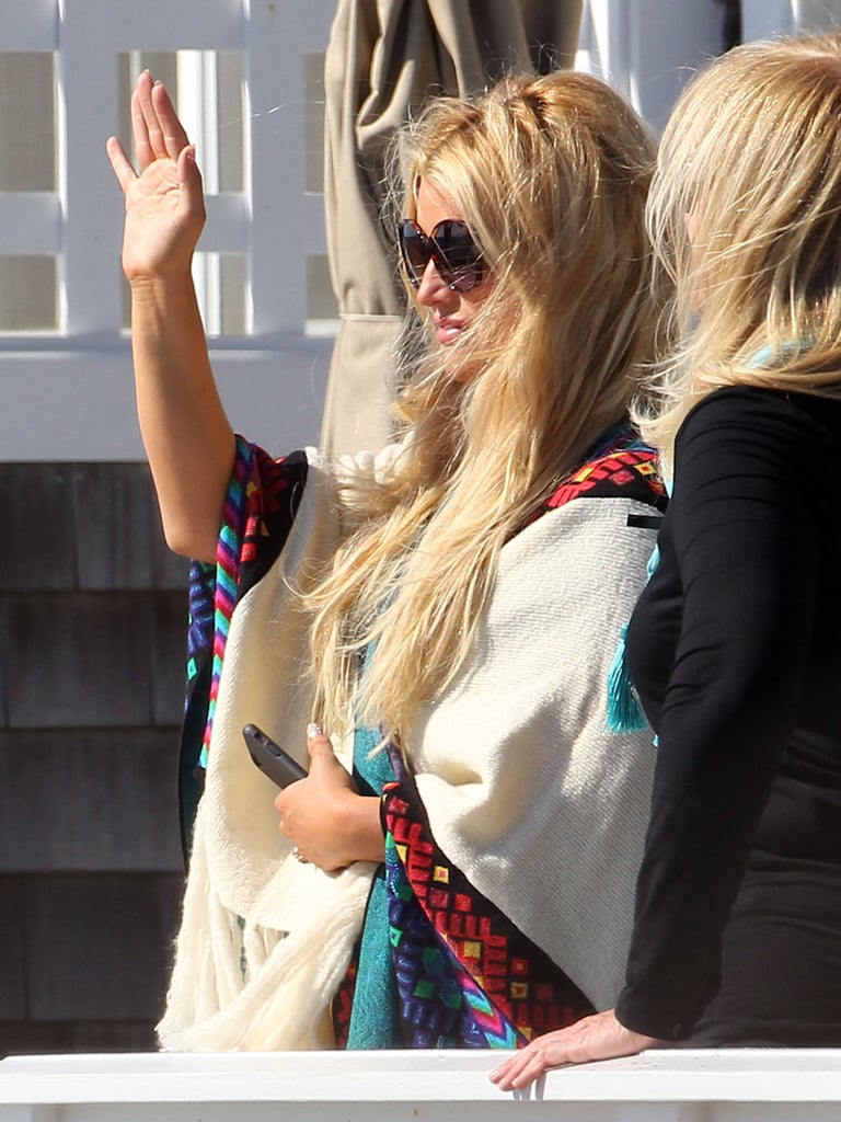 Jessica Simpson waved to her family as they walked on the beach.