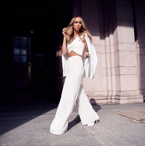 Sleek, milk-white trousers scream Summer, and a crisscross crop top is the ultimate waist flatterer. Source: Instagram user lisaolssonblog