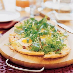 Serve up some quick snacks with a delicious flatbread with eggs, bacon, and frisée.
