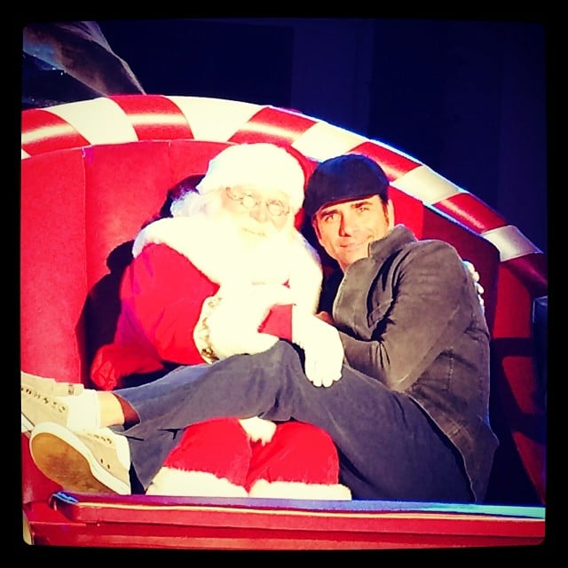 """John Stamos got up close and personal with Santa in this snap, which he cleverly captioned, """"This guy sleighs me."""" Source: Instagram user johnstamos"""