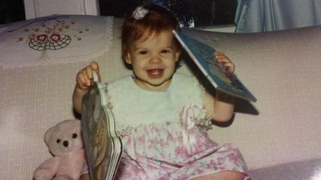 """""""The photo was taken in 1991 when my mom was reading to me. Apparently I really enjoyed the books that played songs!"""" —  Jennifer Michalski, editorial intern, POPSUGAR"""