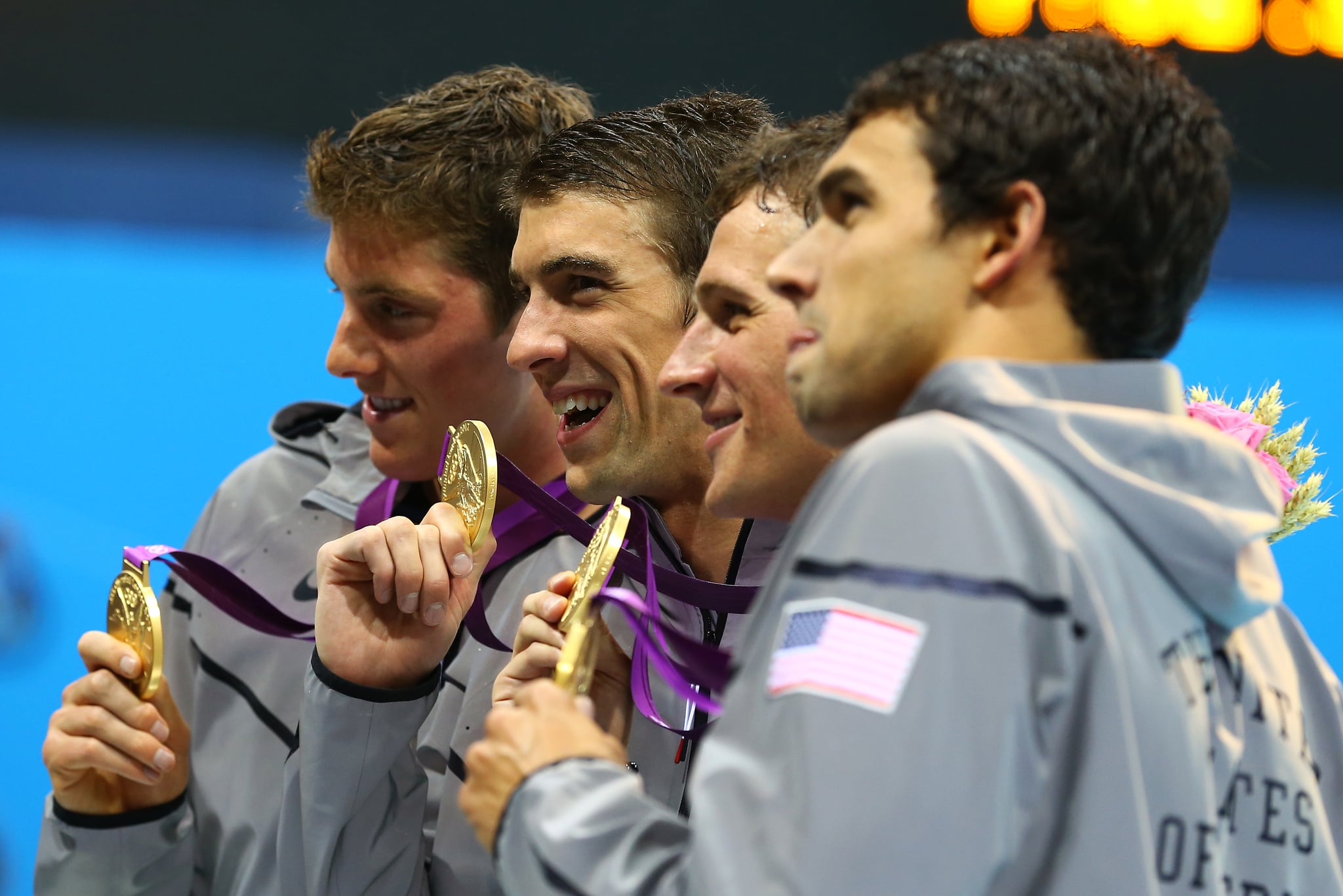 Michael Phelps snapped a photo with the USA relay team.