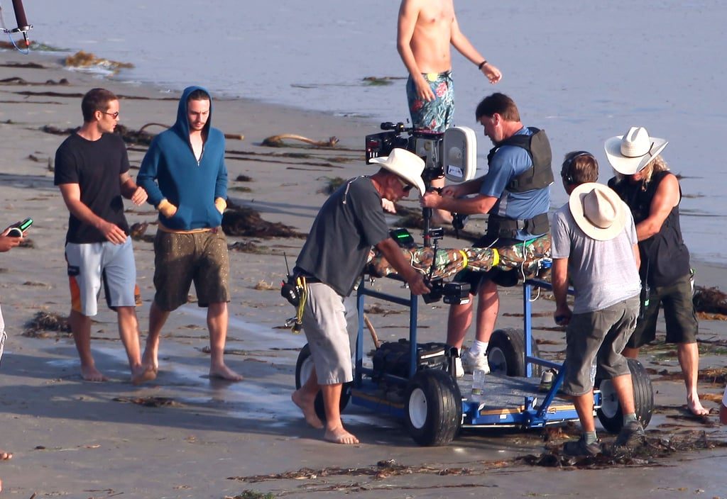Taylor Kitsch and Aaron Johnson shared a beach scene.