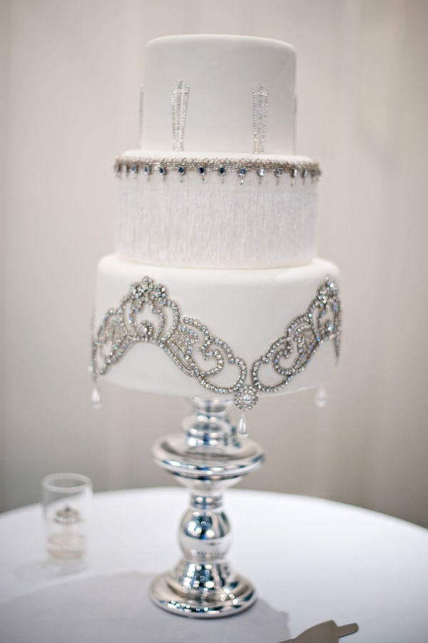 This romantic cake is dripping in elegance and is almost — emphasis on almost — too pretty to eat.  Photo by Kristen Weaver Photography via Style Me Pretty
