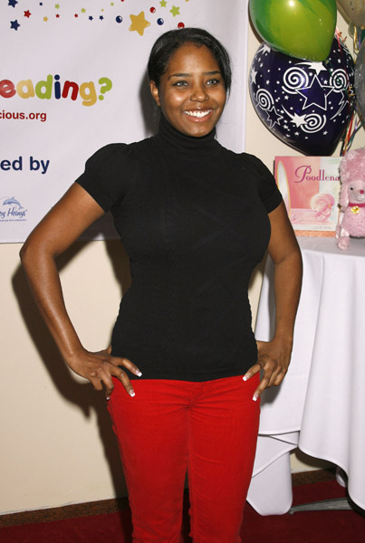 Shar Jackson had her mini–me in tote with her to read to the kids.