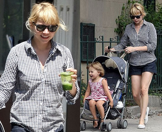 Michelle Williams in a black and white gingham shirt with baby Matilda