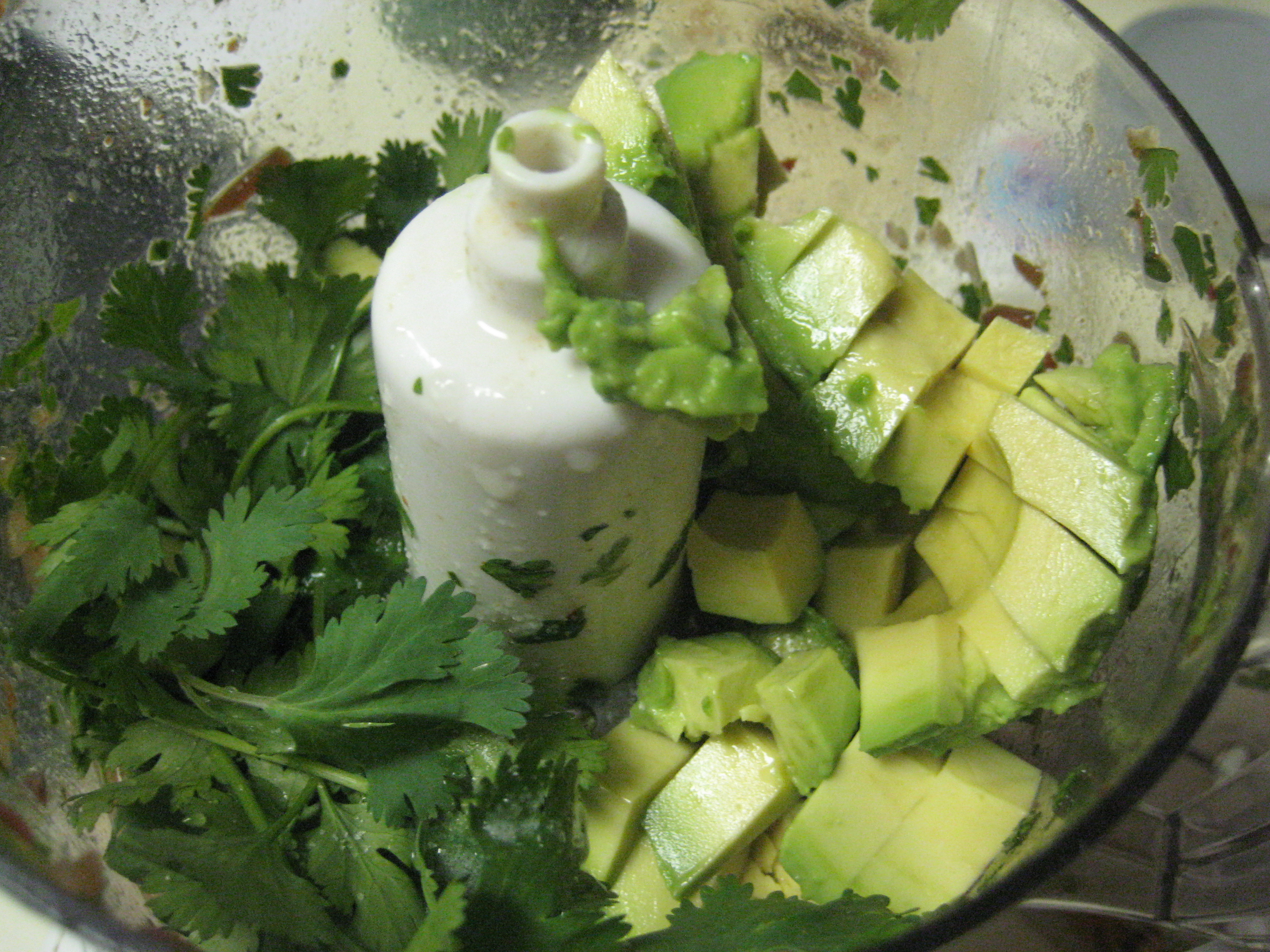 Mixing the guacamole in the food processor.