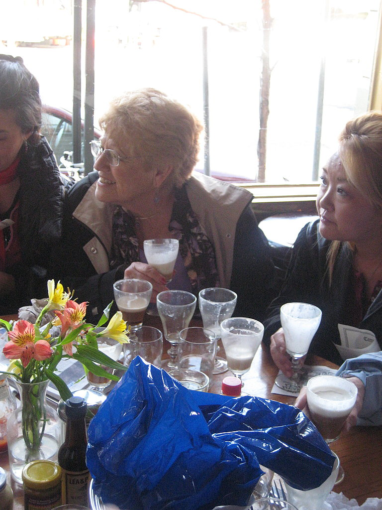 An old women was surrounded by empty glasses!