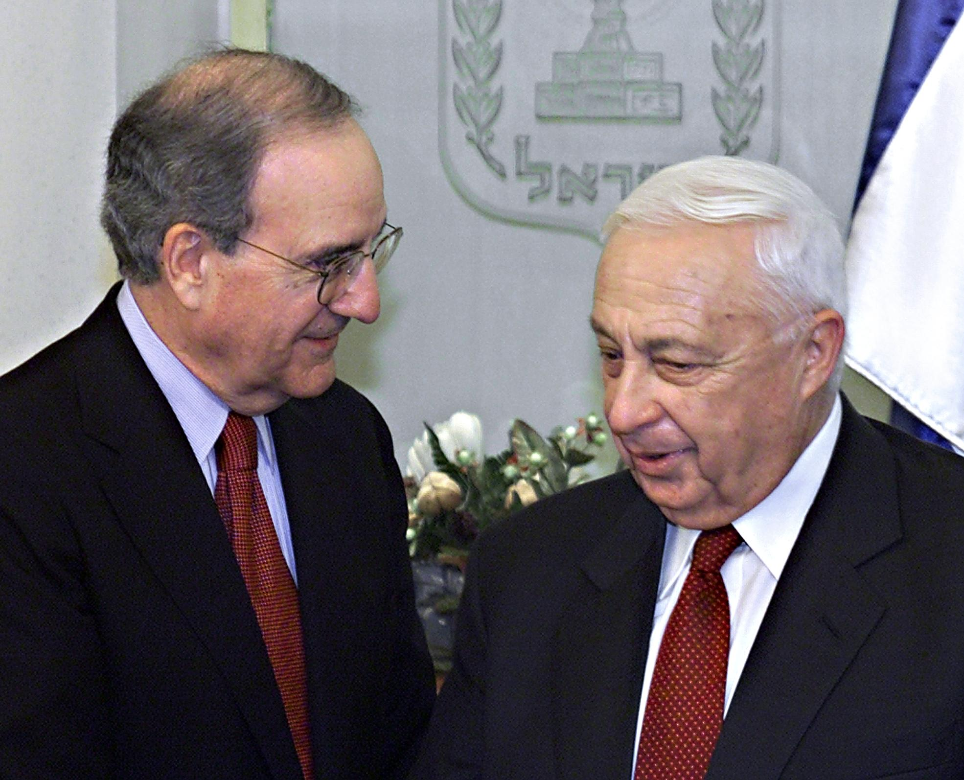 Mitchell speaks to former Israel PM Ariel Sharon, while serving as head of commission on Israel and Palestine in 2001.