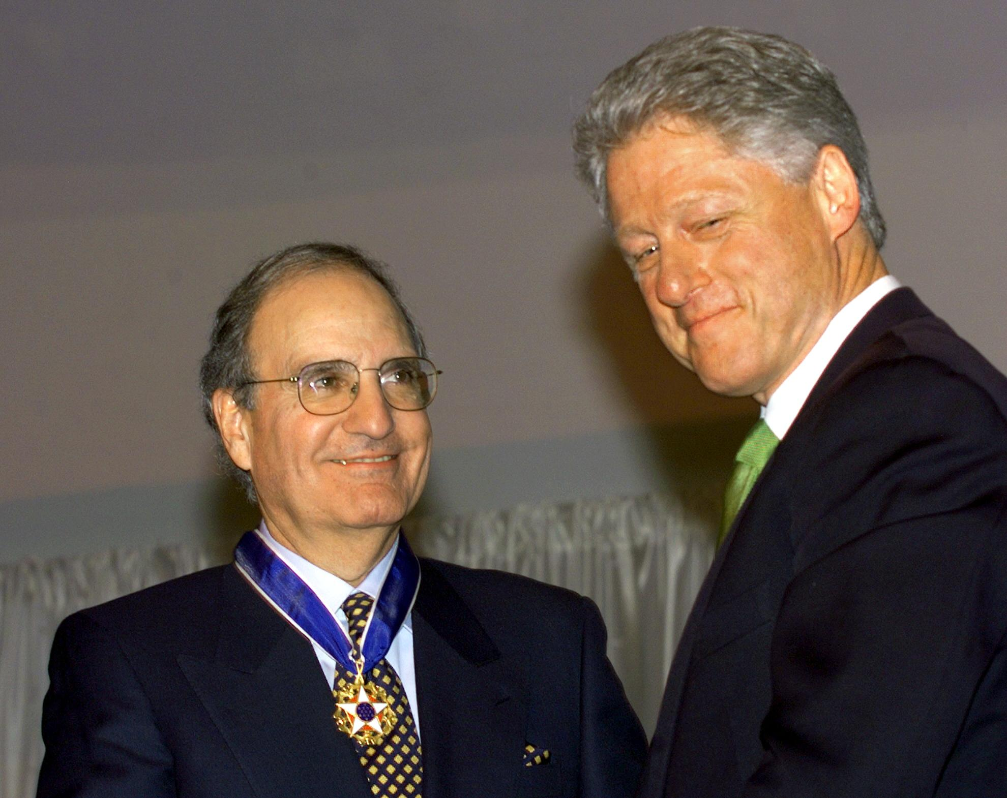 Mitchell receives the Presidential Medal of Freedom for his work to bring peace to Northern Ireland.