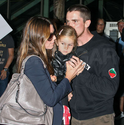 The Bale Family Gives Smooches at LAX