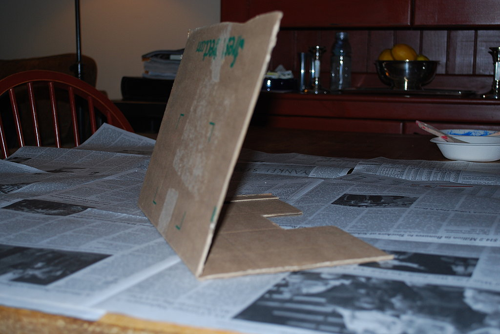 Use another spare piece of cardboard to create a windshield.  The piece of cardboard should be the same width as the body of the