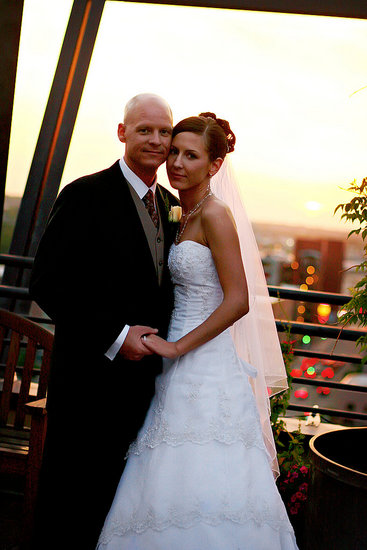 The happy couple with the perfect backdrop of the city and the setting sun