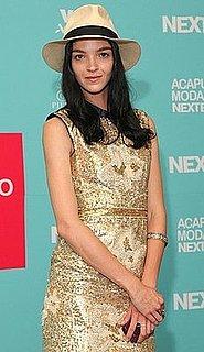Model Mariacarla Boscono Attends Acapulco Moda Nextel 2009 in Fedora and Gold Dress