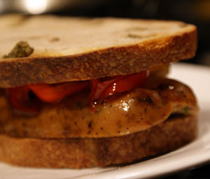 Grilled Gourmet Sausage Sandwich on Olive Bread