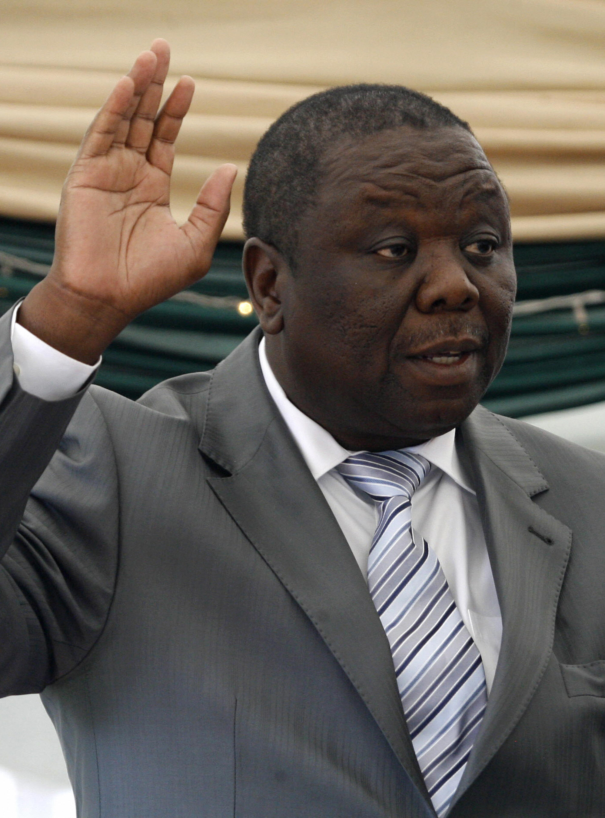 Opposition leader Morgan Tsvangirai is sworn in as prime minister.