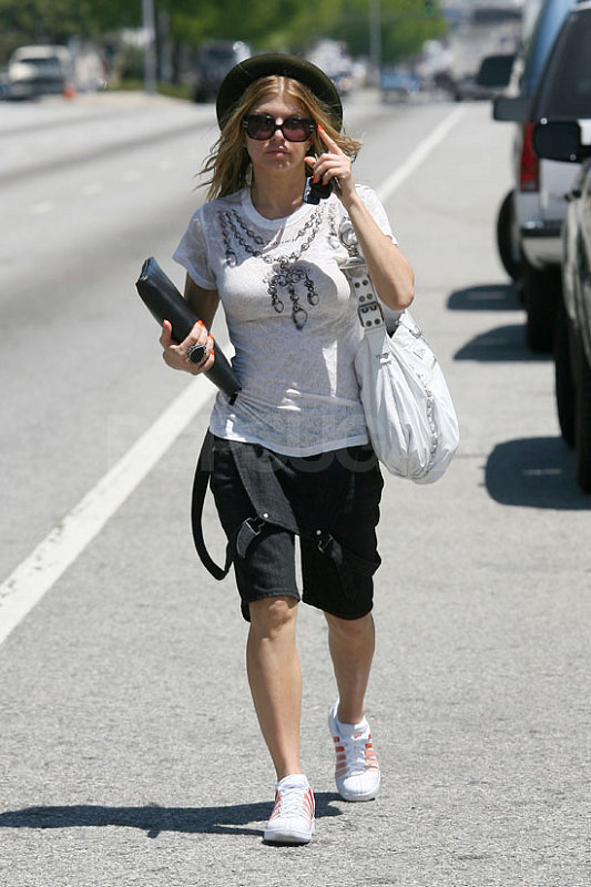 Fergie Takes A Leisurely Stroll by the Highway