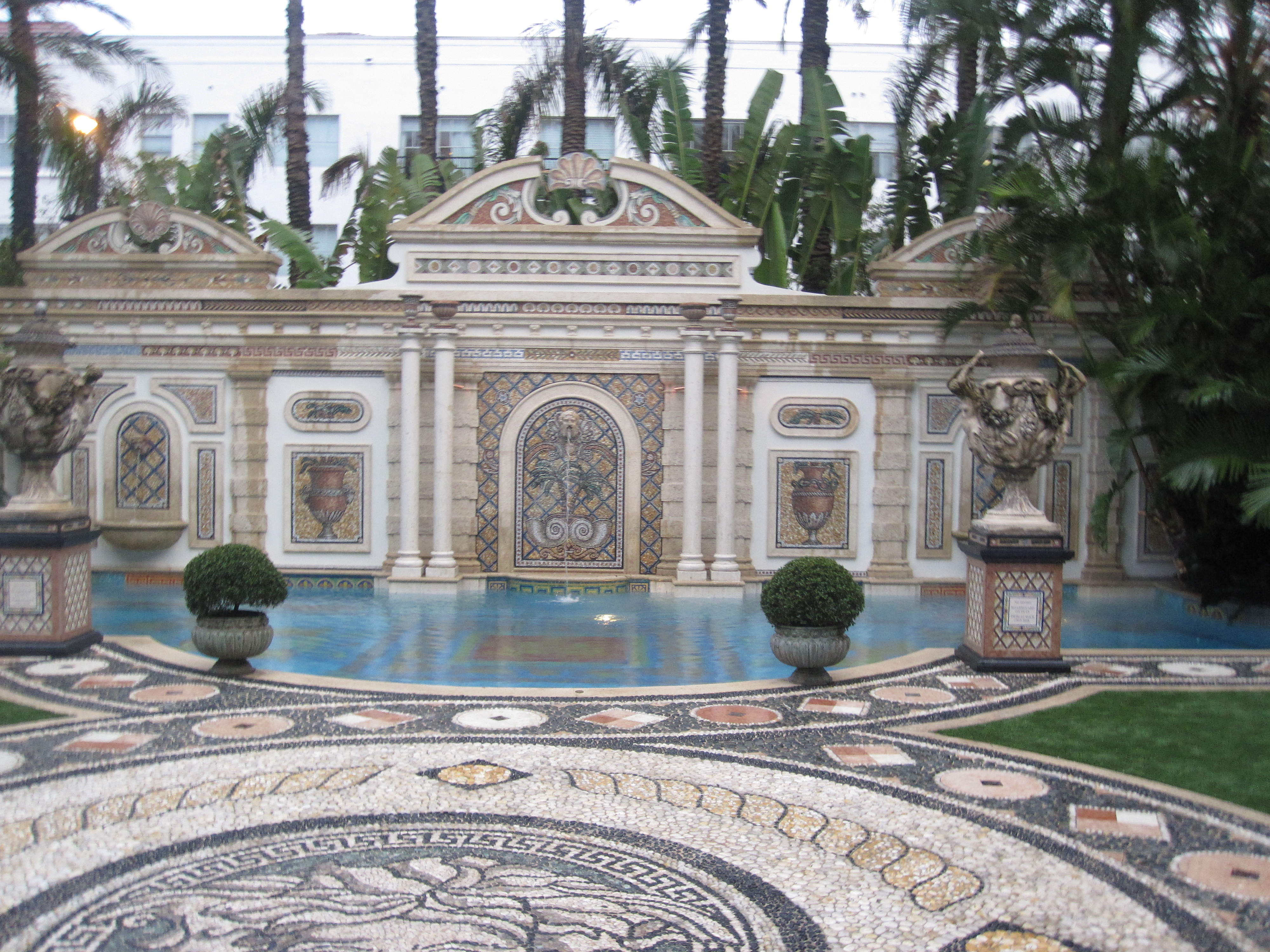 The beautiful pool and patio was meant to be the lush backdrop to a fabulous fete. Instead it's deserted due to the rain.