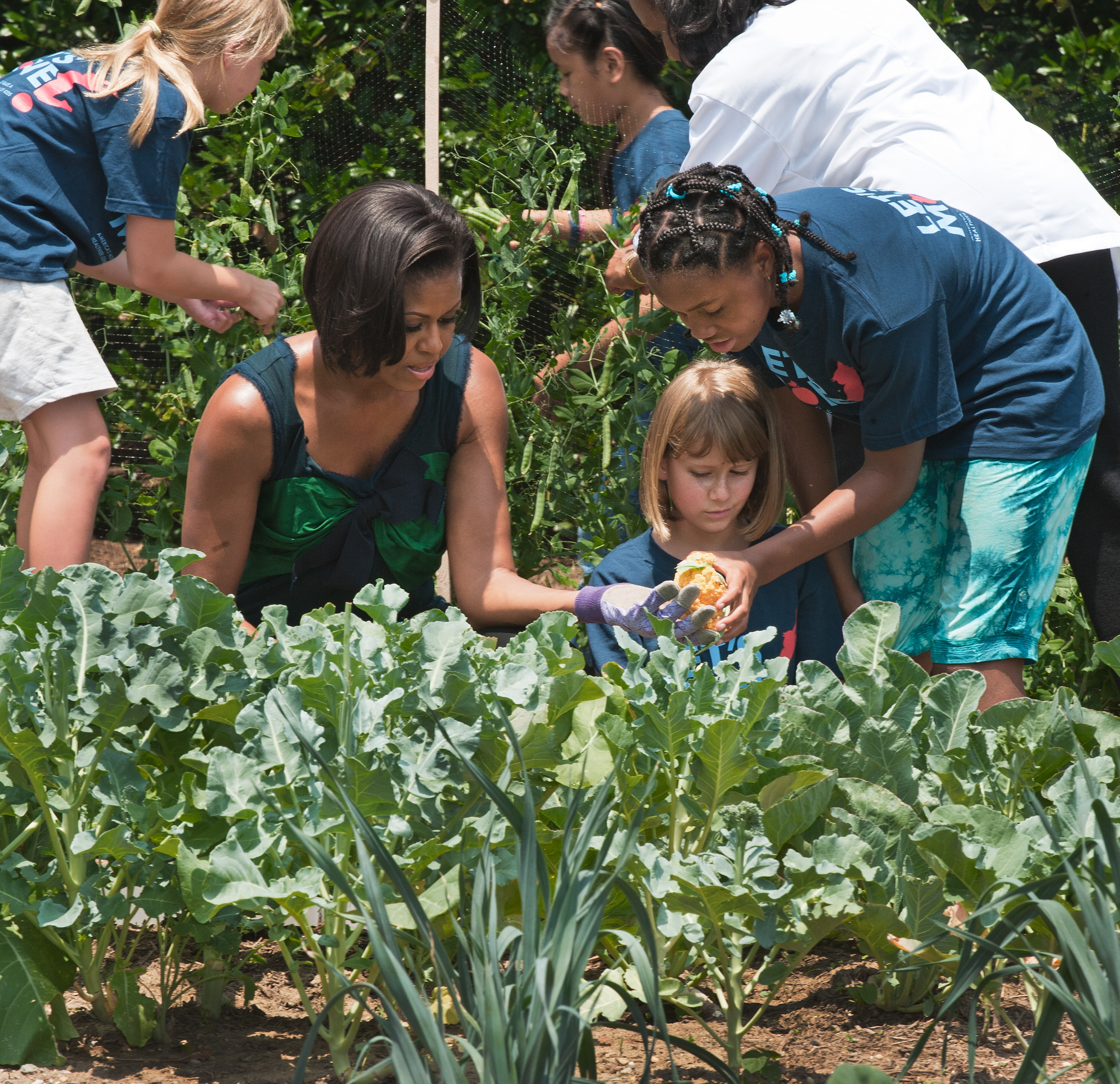 Even the hot, humid weather wasn't enough to keep the First Lady away from her garden. Here, she's shown with students from Hollin Meadows Elementary in Alexandria, VA.