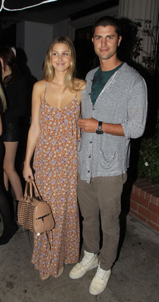 Whitney's flowered maxi is the standout, while Ben's cardigan and trousers just compliment on a casual date night.