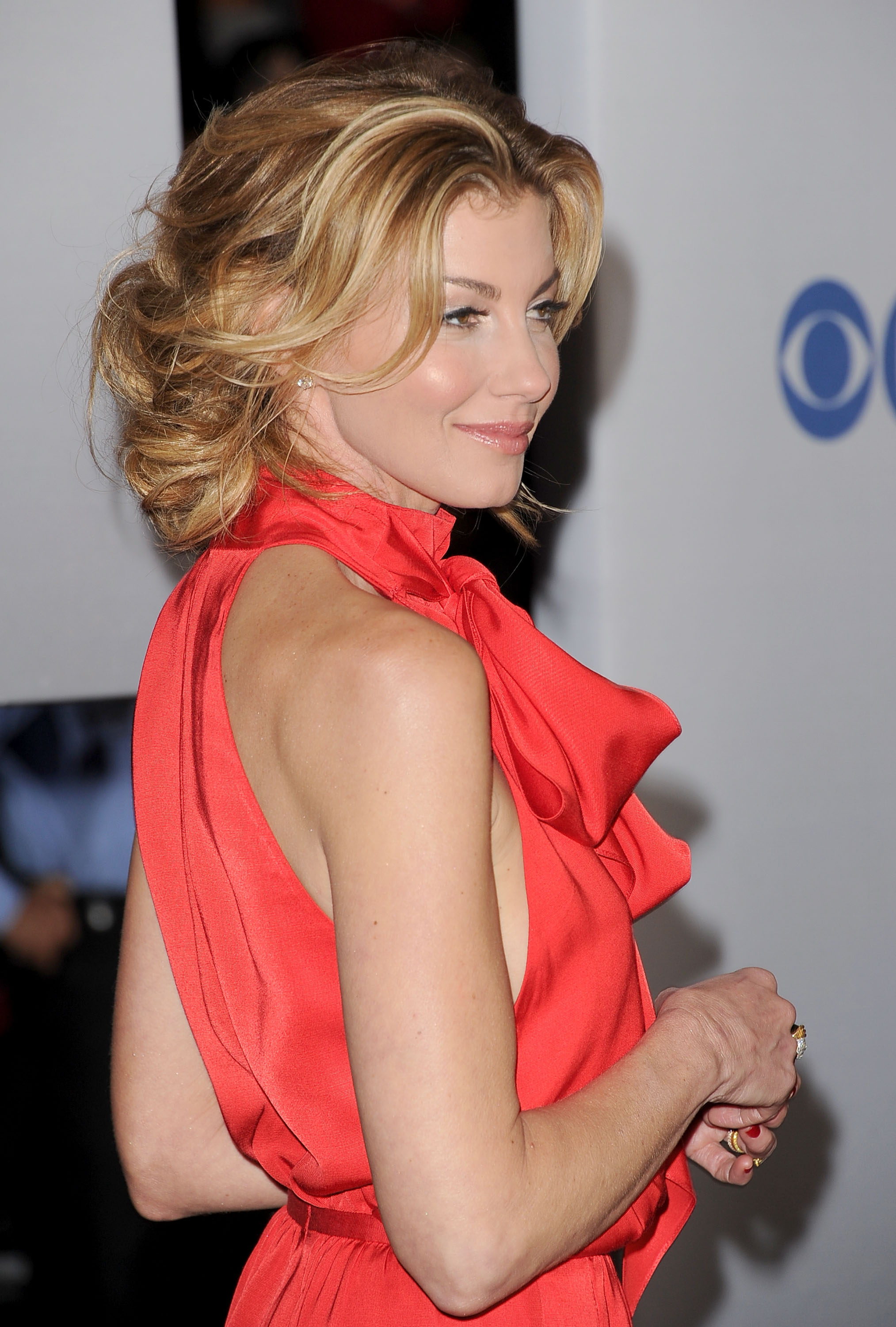 Faith Hill was in a red sleeveless look.