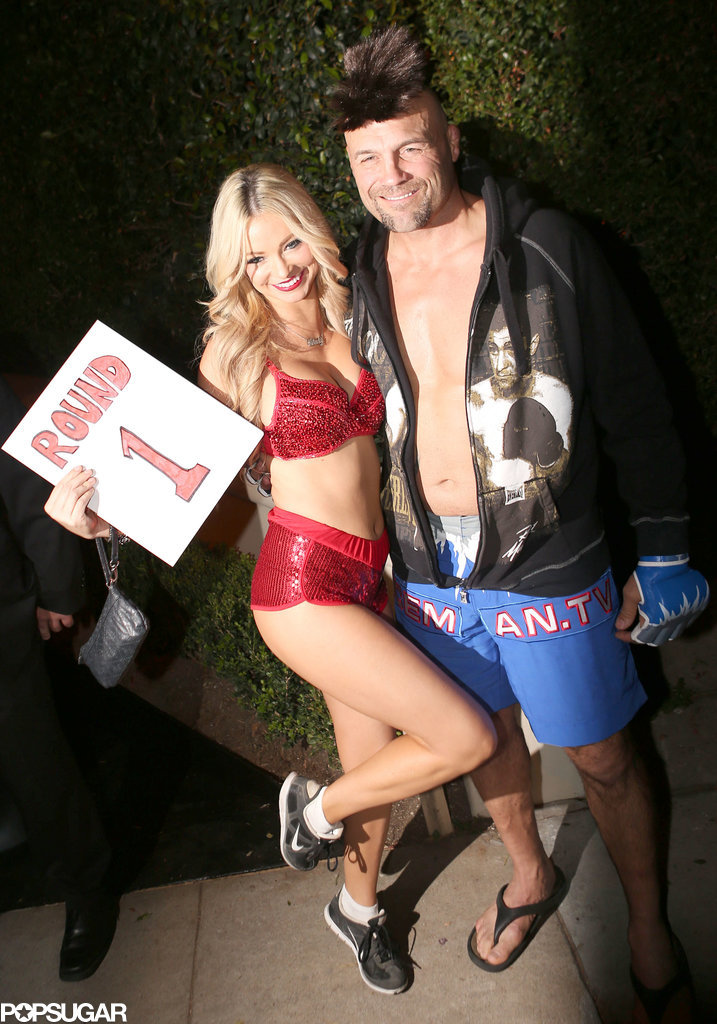 Randy Couture and His Date as a Fighter and a Ring Girl