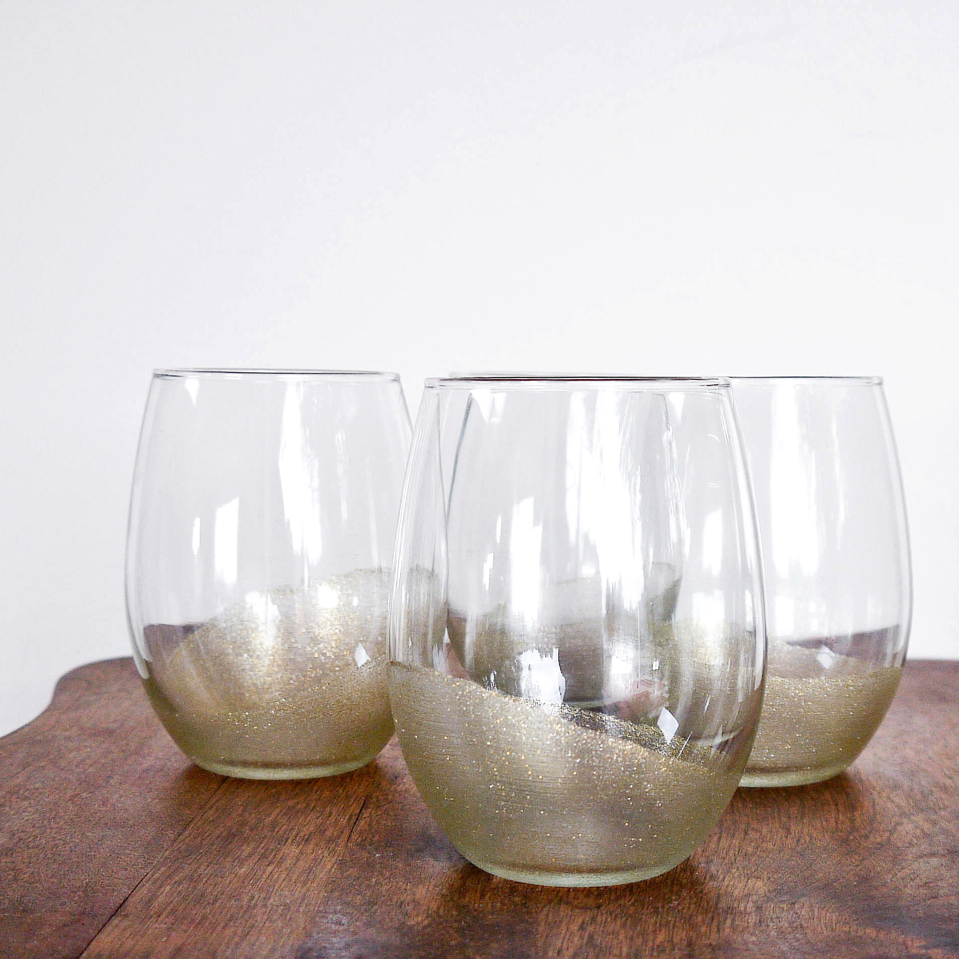 Glitter painted glasses popsugar smart living for Type of paint to use on wine glasses