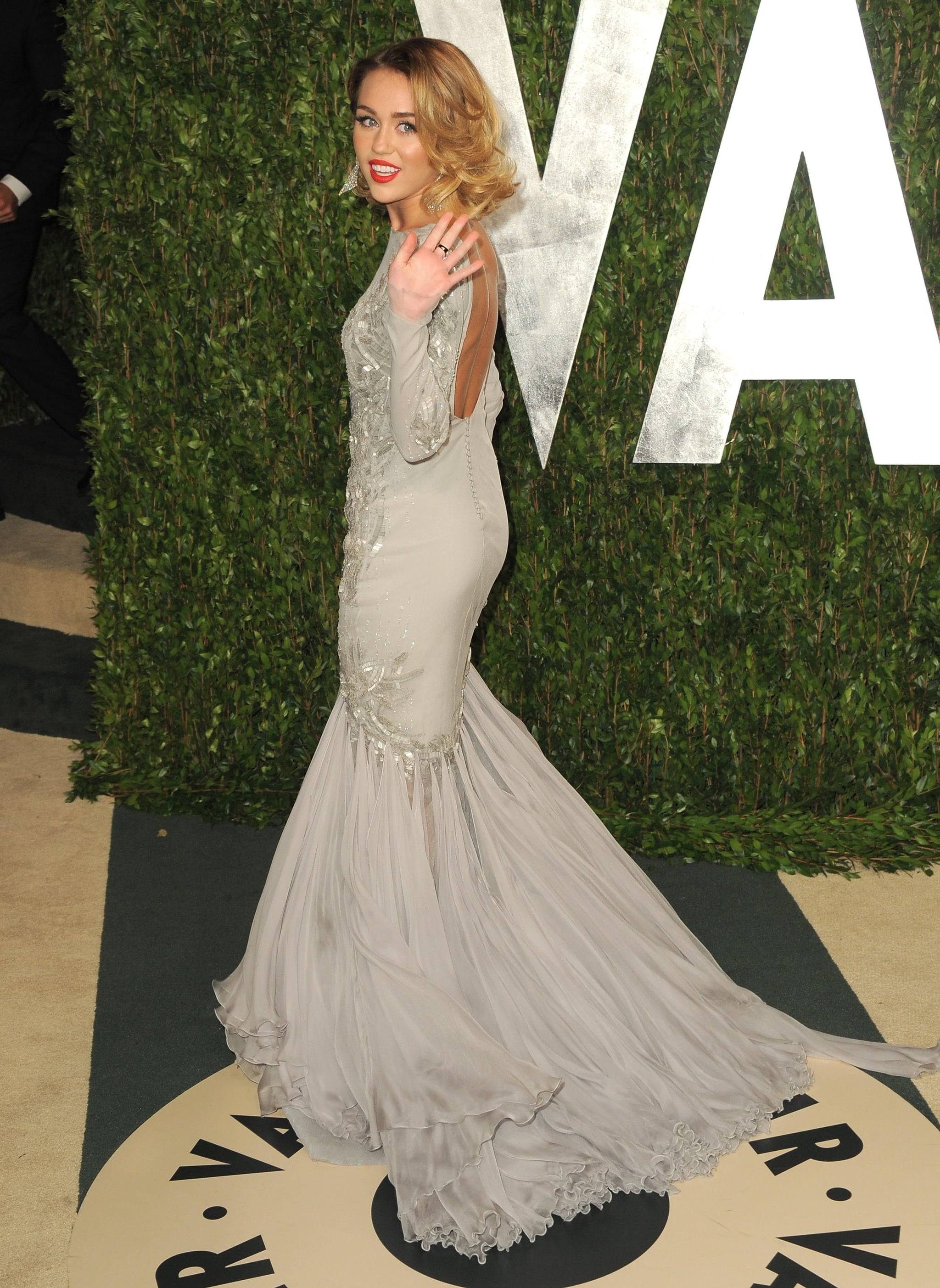 Miley Cyrus makes her way into the Vanity Fair party.