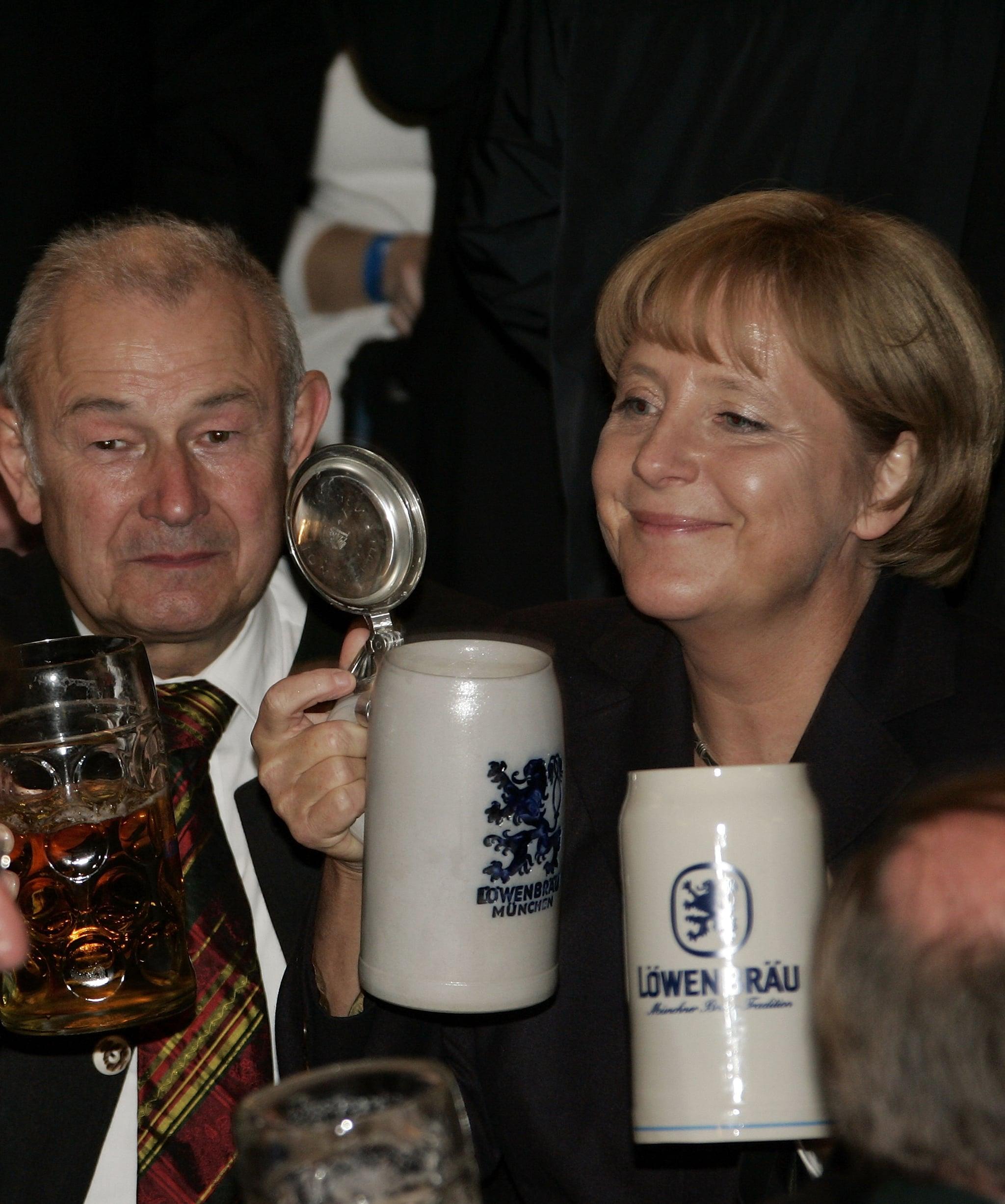 Bavaria's state governor Guenther Beckstein and German Chancellor Angela Merkel