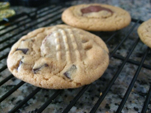 Peanut butter chocolate chip cookies with a hidden pb cup surprise!