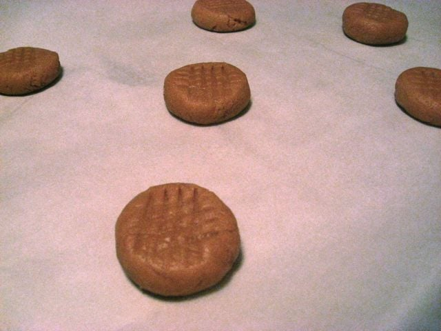 Set the rounded ball of dough on the cookie sheet and use a flat-bottomed glass to smoosh it out a bit.