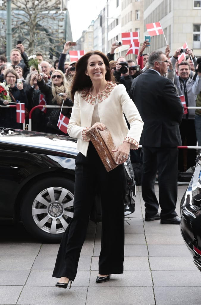 Crown Princess Mary of Denmark wearing a Tory Burch jacket at the Hamburg Town Hall in 2015.